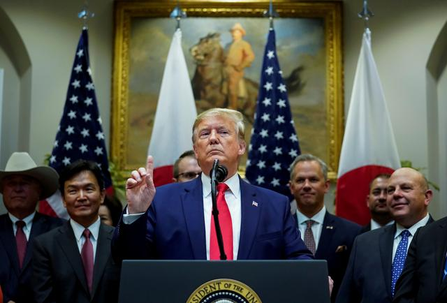 FILE PHOTO: U.S. President Donald Trump speaks about Turkey and Syria during a formal signing ceremony for the U.S.-Japan Trade Agreement at the White House in Washington, October 7, 2019.  REUTERS/Kevin Lamarque/File Photo