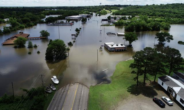 FILE PHOTO: A road submerged in the flood waters of the Arkansas River is shown in this aerial photo in Fort Smith, Arkansas, U.S., May 30, 2019.  To match Special Report USA-FUNDS/INDEX-CLIMATECHANGE  REUTERS/Drone Base
