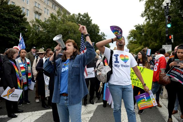 LGBTQ activists and supporters hold a rally near the steps of the Supreme Court as it hears major LGBT rights case on whether federal employment law that outlaws discrimination on the basis of sex covers sexual orientation and gender identity in Washington, U.S., October 8, 2019.      REUTERS/Mary F. Calvert
