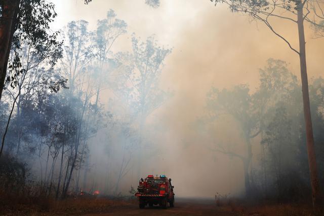 Firefighters battle bushfires in Busbys Flat, northern NSW, Australia, October 9, 2019. AAP Image/Jason O'Brien/via REUTERS
