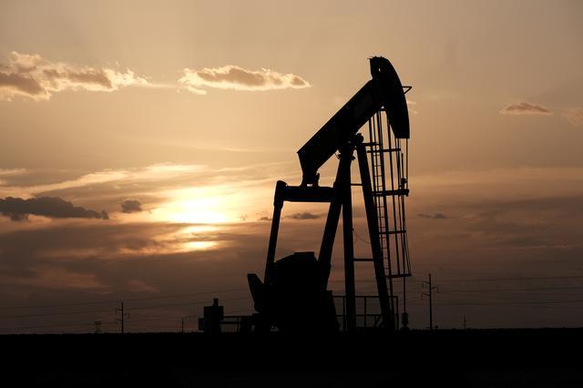 FILE PHOTO: Oil pump jacks work at sunset near Midland, Texas, U.S., August 21, 2019.  REUTERS/Jessica Lutz/Files