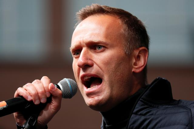 FILE PHOTO: Russian opposition leader Alexei Navalny delivers a speech during a rally to demand the release of jailed protesters, who were detained during opposition demonstrations for fair elections, in Moscow, Russia September 29, 2019. REUTERS/Shamil Zhumatov