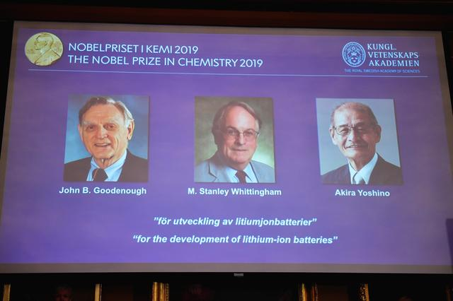 "A screen displays the portraits of the laureates of the 2019 Nobel Prize in Chemistry (L-R) John B. Goodenough, M. Stanley Whittingham, and Akira Yoshino ""for the development of lithium-ion batteries"" during a news conference at the Royal Swedish Academy of Sciences in Stockholm, Sweden, October 9, 2019. Naina Helen Jama/TT News Agency/via REUTERS"