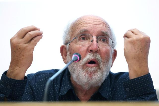 Swiss scientist Michel Mayor, one of the winners of the 2019 Nobel Prize for Physics, speaks during a lecture in Torrejon de Ardoz, near Madrid, Spain October 9, 2019. REUTERS/Sergio Perez