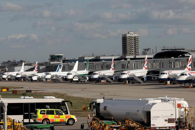 FILE PHOTO: Passenger jets stand on the runway of London City Airport, in London, Britain February 12, 2018. REUTERS/Simon Dawson/File Photo