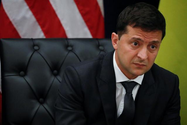 FILE PHOTO: Ukraine's President Volodymyr Zelenskiy listens during a bilateral meeting with U.S. President Donald Trump on the sidelines of the 74th session of the United Nations General Assembly (UNGA) in New York City, New York, U.S., September 25, 2019. REUTERS/Jonathan Ernst