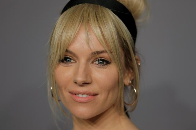 FILE PHOTO: Actor Sienna Miller arrives for an amfAR gala to celebrate Lee Daniels during New York Fashion Week in New York U.S., February 7, 2018. REUTERS/Lucas Jackson/File Photo