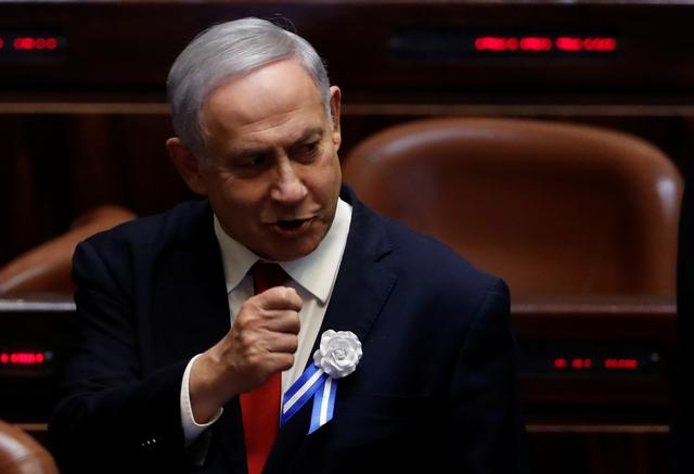 FILE PHOTO: Israeli Prime Minister Benjamin Netanyahu attends the swearing-in ceremony of the 22nd Knesset, the Israeli parliament, in Jerusalem October 3, 2019. REUTERS/Ronen Zvulun