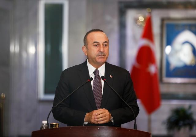 FILE PHOTO: Turkish Foreign Minister Mevlut Cavusoglu speaks during a news conference with Iraqi Foreign Minister Mohamed Ali Alhakim in Baghdad, Iraq April 28, 2019. REUTERS/Khalid Al-Mousily