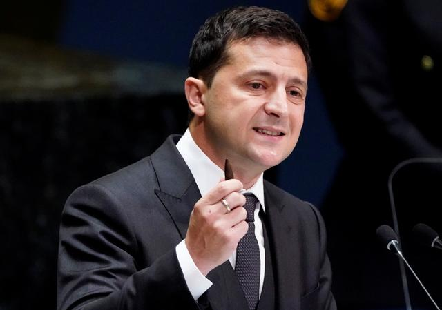 FILE PHOTO: Ukraine's President Volodymyr Zelenskiy holds a bullet as he addresses the 74th session of the United Nations General Assembly at U.N. headquarters in New York City, New York, U.S., September 25, 2019.