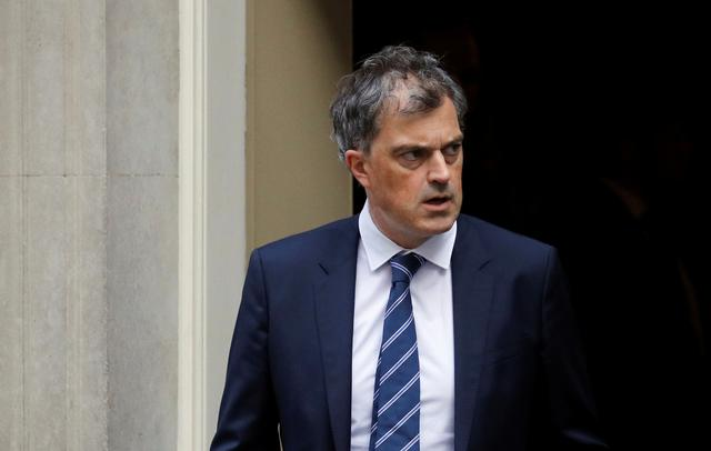 FILE PHOTO: Northern Ireland Secretary Julian Smith walks outside 10 Downing Street in London, Britain September 17, 2019.  REUTERS/Phil Noble
