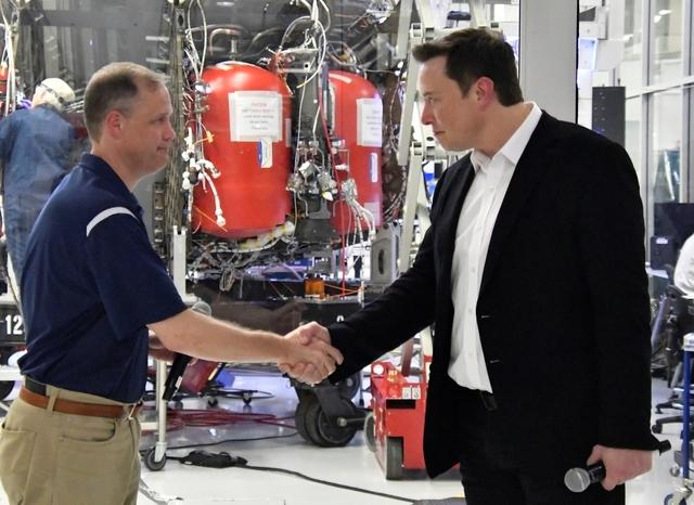NASA Administrator Jim Bridenstine (L) and SpaceX Chief Engineer Elon Musk shake hands after a tour of SpaceX headquarters in Hawthorne, California, U.S. October 10, 2019. REUTERS/ Gene Blevins