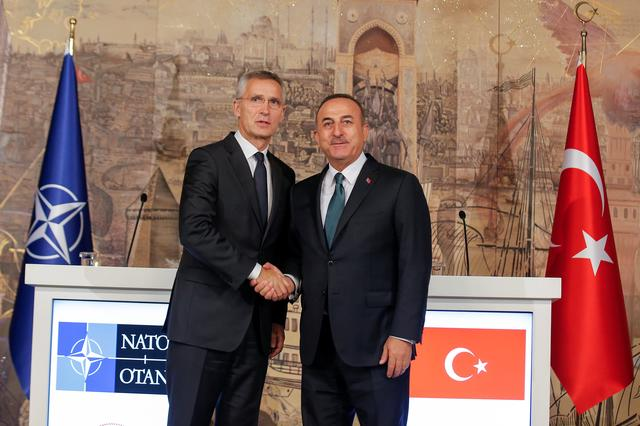 Turkish Foreign Minister Mevlut Cavusoglu shakes hands with NATO Secretary-General Jens Stoltenberg after a news conference in Istanbul, Turkey, October 11, 2019. REUTERS/Huseyin Aldemir