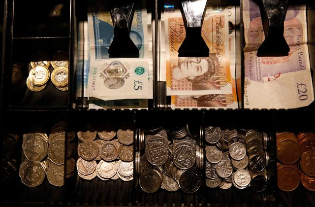 FILE PHOTO: Pound Sterling notes and change are seen inside a cash resgister in a coffee shop in Manchester, Britain, Septem,ber 21, 2018. REUTERS/Phil Noble