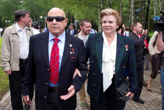 FILE PHOTO: Russian cosmonaut Alexei Leonov (L), the first human to conduct a space walk, and his compatriot Valentina Tereshkova, the first woman cosmonaut, attend a ceremony in Star City outside Moscow, Russia, June 7, 2013. REUTERS/Sergei Remezov/File Photo