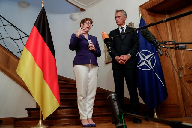 FILE PHOTO: NATO Secretary General Jens Stoltenberg meets with German Defence Minister Annegret Kramp-Karrenbauer in Brussels, Belgium July 31, 2019.  Stephanie Lecocq/Pool via REUTERS/File Photo