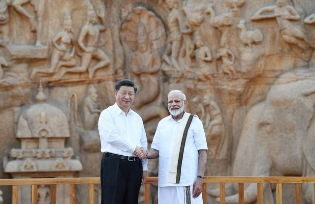 China's President Xi Jinping shakes hand with India's Prime Minister Narendra Modi during their visit to Arjuna's Penance in Mamallapuram on the outskirts of Chennai, India, October 11, 2019. India's Press Information Bureau/Handout via REUTERS  ATTENTION EDITORS - THIS IMAGE WAS PROVIDED BY A THIRD PARTY. NO RESALES. NO ARCHIVES.