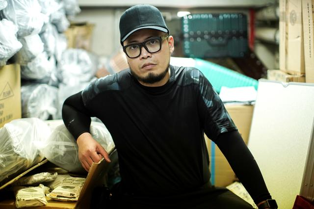 "Keita Lee, 33, owner of the ""National Calamity Hardware Store"" poses at his shop in Hong Kong, China, September 27, 2019. REUTERS/Athit Perawongmetha"