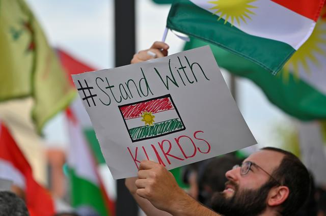 A crowd of over 500 people protest in support of Kurds after the Trump administration changed its policy in Syria, in front of the federal courthouse in Nashville, Tennessee, U.S. October 11, 2019.  REUTERS/Harrison McClary