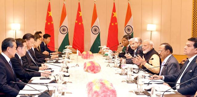 India's Prime Minister Narendra Modi (3rd R) and China's President Xi Jinping (3rd L) attend delegation level talks in Mamallapuram on the outskirts of Chennai, India, October 12, 2019. India's Press Information Bureau/Handout via REUTERS