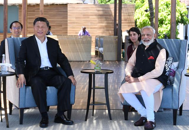 India's Prime Minister Narendra Modi and China's President Xi Jinping look on during their meeting in Mamallapuram on the outskirts of Chennai, India, October 12, 2019. India's Press Information Bureau/Handout via REUTERS