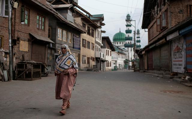 FILE PHOTO: A Kashmiri woman walks through an empty street in Anchar neighbourhood, during restrictions following the scrapping of the special constitutional status for Kashmir by the Indian government, in Srinagar, September 20, 2019. REUTERS/Danish Siddiqui