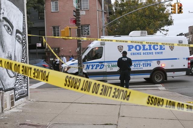 Police are pictured on the scene of a shooting at Triple A Aces club in the Brooklyn borough of New York City, New York, U.S., October 12, 2019. REUTERS/Lloyd Mitchell