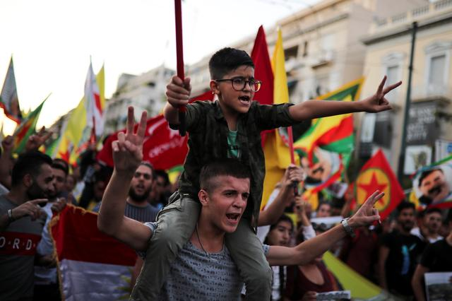 Kurds living in Greece shout slogans during a demonstration against Turkey's military action in northeastern Syria, in Athens, Greece, October 12, 2019. REUTERS/Alkis Konstantinidis