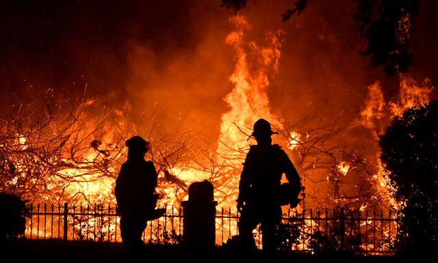 FILE PHOTO: Firefighters battle a wind-driven wildfire called the Saddle Ridge fire in the early morning hours Friday in Porter Ranch, California, U.S., October 11, 2019.  REUTERS/Gene Blevins/File Photo