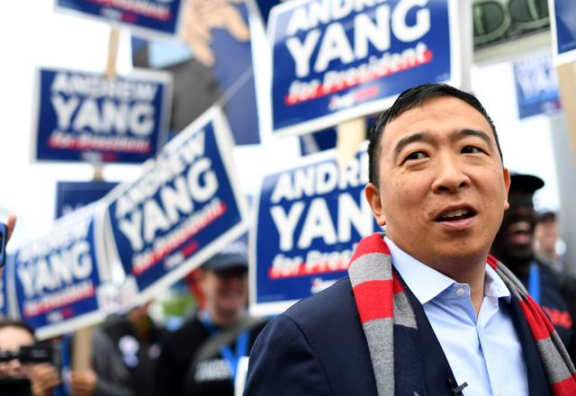 FILE PHOTO: Democratic 2020 U.S. presidential candidate and entrepreneur Andrew Yang greets supporters at the New Hampshire Democratic Party state convention in Manchester, New Hampshire, U.S. September 7, 2019. REUTERS/Gretchen Ertl