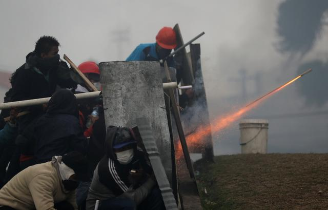 Demonstrators fire a homemade weapon during a protest against Ecuador's President Lenin Moreno's austerity measures, in Quito, Ecuador October 13, 2019.  REUTERS/Ivan Alvarado
