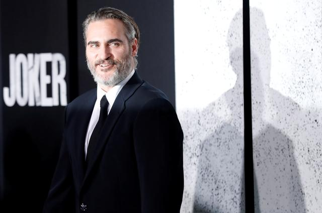 "FILE PHOTO: Joaquin Phoenix attends the premiere for the film ""Joker"" in Los Angeles, California, U.S., September 28, 2019. REUTERS/Mario Anzuoni"