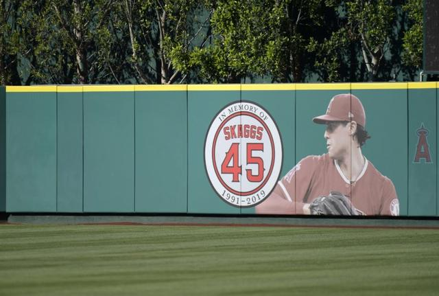 FILE PHOTO: Jul 17, 2019; Anaheim, CA, USA; Detailed view of a memorial for Los Angeles Angels pitcher Tyler Skaggs on the outfield wall  at Angel Stadium of Anaheim. Skaggs, 27, died at a hotel in Southlake, Texas, July 1, 2019, where he was found unresponsive prior to a game against the Texas Rangers. Mandatory Credit: Kirby Lee-USA TODAY Sports