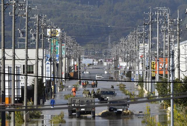 A residential area flooded by the Chikuma river, caused by Typhoon Hagibis is seen in Nagano, central Japan, October 13, 2019, in this photo taken by Kyodo. Mandatory credit Kyodo/via REUTERS A