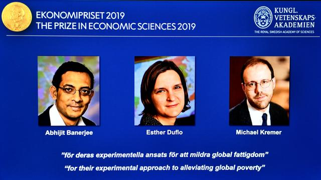 The portraits of Abhijit Banerjee, Esther Duflo, and Michael Kreme, who have been announced the Nobel Prize in Economic Sciences 2019 winners, are seen at a news conference at the Royal Swedish Academy of Sciences in Stockholm, Sweden, October 14, 2019. Karin Wesslen/TT News Agency/via REUTERS