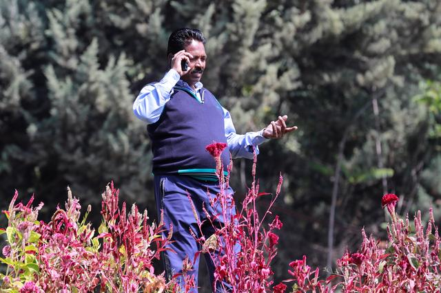 A man speaks on the phone after the partial restoration of mobile phone services in Srinagar October 14, 2019. REUTERS/Danish Ismail