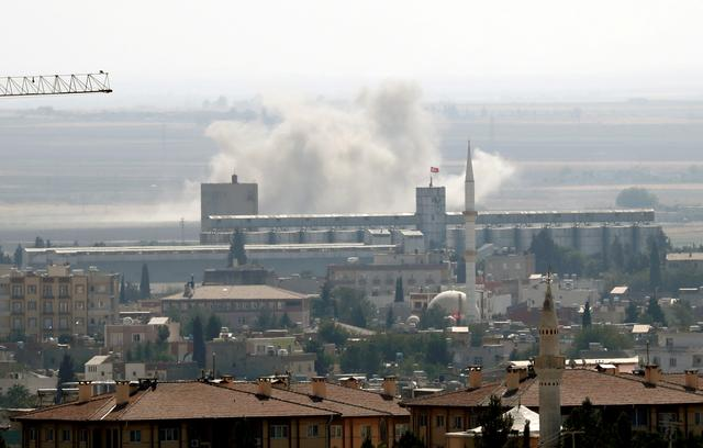 FILE PHOTO: Smoke billows out after Turkish shelling on the Syrian border town of Ras al Ain, as seen from Ceylanpinar, in Sanliurfa province, Turkey, October 13, 2019. REUTERS/Murad Sezer/File Photo