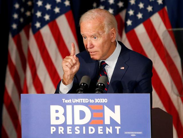 FILE PHOTO: Democratic 2020 U.S. presidential candidate and former Vice President Joe Biden gestures as he speaks at a campaign town hall meeting in Rochester, New Hampshire, U.S., October 9, 2019.   REUTERS/Mary Schwalm/File Photo