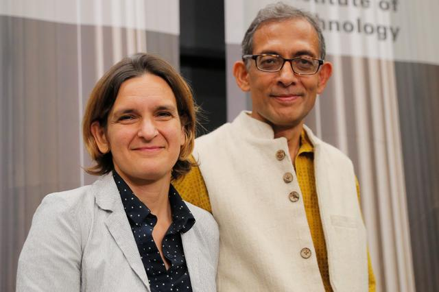 Abhijit Banerjee and Esther Duflo, two of the three winners of the 2019 Nobel Prize in Economics, stand together at a news conference at the Massachusetts Institute of Technology (MIT) in Cambridge, Massachusetts, U.S., October 14, 2019.     REUTERS/Brian Snyder
