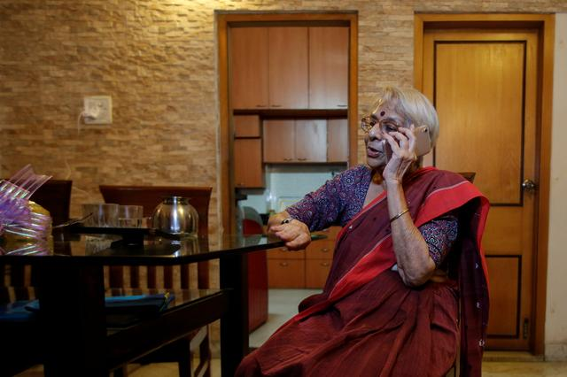 Nirmala Banerjee, mother of Abhijit Banerjee, one of the winners of 2019 Nobel Economics Prize, speaks on the phone at her house in Kolkata, India, October 14, 2019. REUTERS/Rupak De Chowdhuri
