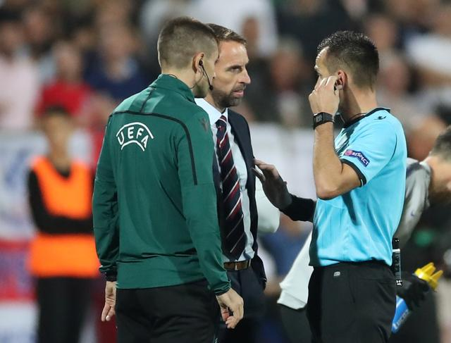 Soccer Football - Euro 2020 Qualifier - Group A - Bulgaria v England - Vasil Levski National Stadium, Sofia, Bulgaria - October 14, 2019  England manager Gareth Southgate speaks to referee Ivan Bebek as the match is stopped during the first half  Action Images via Reuters/Carl Recine