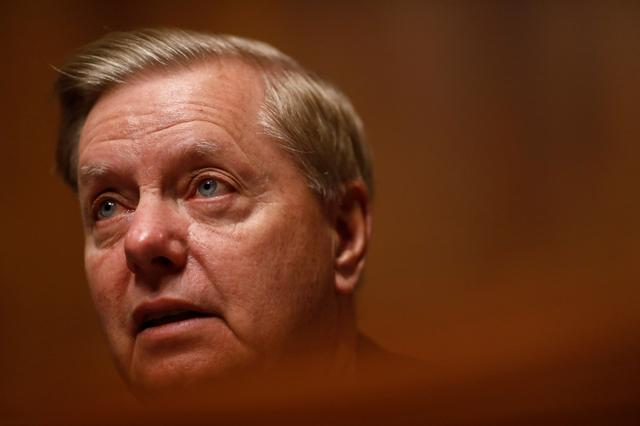"""FILE PHOTO: Chairman Lindsey Graham speaks as FBI Director Christopher Wray testifies before a Senate Judiciary Committee hearing on """"Oversight of the Federal Bureau of Investigation"""" on Capitol Hill in Washington, U.S. July 23, 2019. REUTERS/Eric Thayer"""