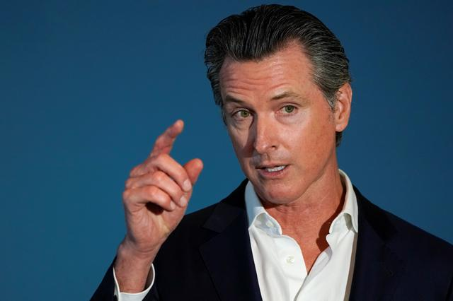 FILE PHOTO: California governor Gavin Newsom speaks at a news conference as he signs SB 113, which will enable the transfer of $331million in state funds to the National Mortgage Special Deposit Fund in San Diego, California, U.S. October 9, 2019.       REUTERS/ Mike Blake