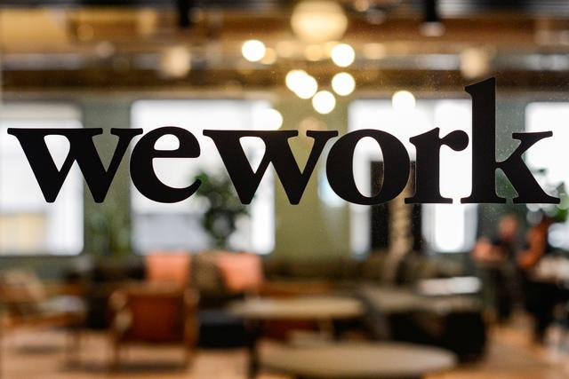 FILE PHOTO: A WeWork logo is seen at a WeWork office in San Francisco, California, U.S. September 30, 2019.  REUTERS/Kate Munsch/File Photo