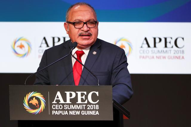 FILE PHOTO: Papua New Guinea Prime Minister Peter O'Neill speaks during the APEC CEO Summit 2018 at Port Moresby, Papua New Guinea, 16 November 2018. Fazry Ismail/Pool via REUTERS