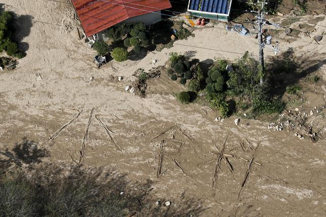 """An aerial view shows the characters for """"water and food"""" written on muddy ground at a flooded area caused by Typhoon Hagibis in Marumori Town, Miyagi prefecture, Japan, October 15, 2019, in this photo taken by Kyodo Mandatory credit Kyodo/via REUTERS"""
