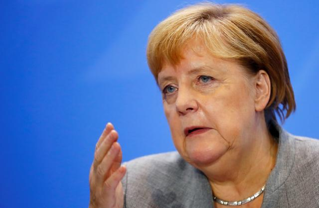 FILE PHOTO: German Chancellor Angela Merkel attends a news conference after meeting with chairmen of international economic and financial organisations at the Chancellery in Berlin, Germany October 1, 2019. REUTERS/Hannibal Hanschke/File Photo