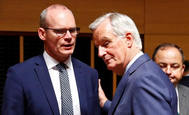 EU's Chief Brexit Negotiator Michel Barnier talks with Irish Foreign Minister Simon Coveney during the General Affairs council addressing the state of play of Brexit, in Luxembourg October 15, 2019.  REUTERS/Francois Lenoir