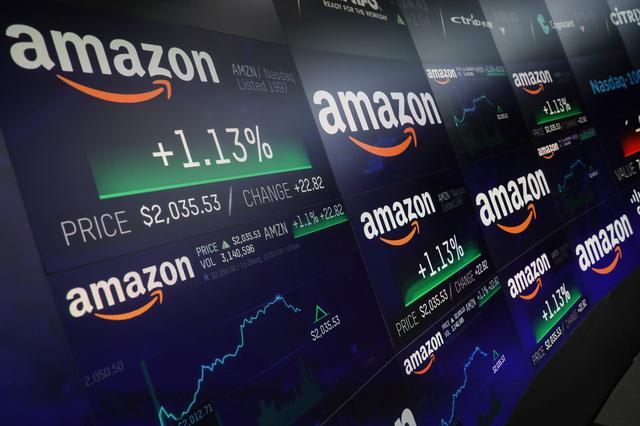 FILE PHOTO: The Amazon.com logo and stock price information is seen on screens at the Nasdaq Market Site in New York City, New York, U.S., September 4, 2018. REUTERS/Mike Segar/File Photo