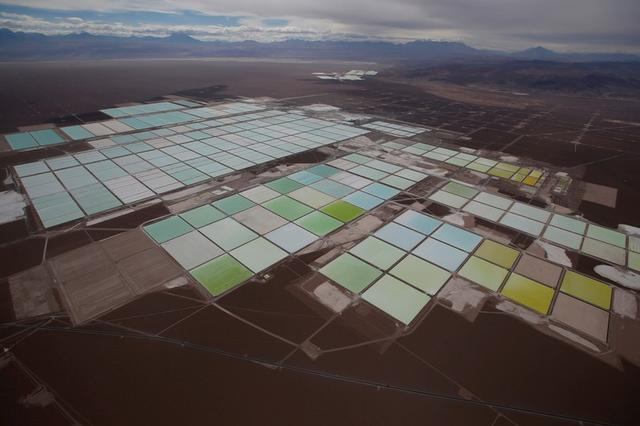 FILE PHOTO: An aerial view shows the brine pools of SQM lithium mine on the Atacama salt flat in the Atacama desert of northern Chile, January 10, 2013. REUTERS/Ivan Alvarado/File Photo
